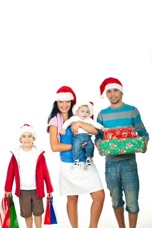 Happy family wearing santa hats and holding Christmas gifts isolated on white background photo