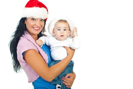 Mother and baby wearing Santa hats and smiling isolated on white background,copy space for text message in right part of image photo