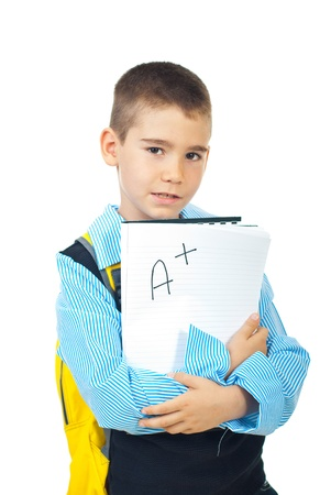 test paper: School boy holding good test result with A +  isolated on white background