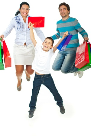 Happy family of three members jumping and holding shopping bags isolated on white background photo