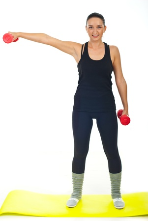 Fitness female working with two red barbell over white background photo