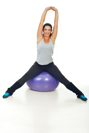 tracksuit: Healthy woman doing fitness exercises on pilates ball Stock Photo