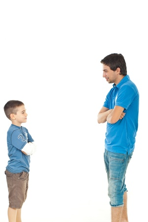 Father and son standing face to face and having conversation isolated on white background photo
