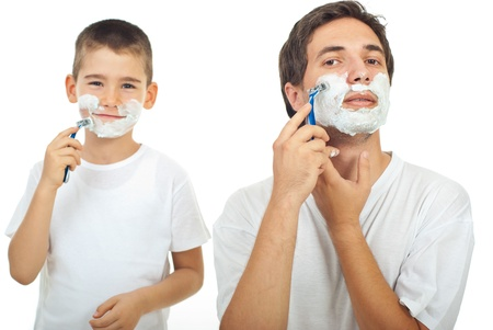 shave: Father shaving in the mirror and the son imitate father in background