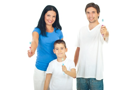 Happy family giving  or showing their toothbrushes isolated on white background photo