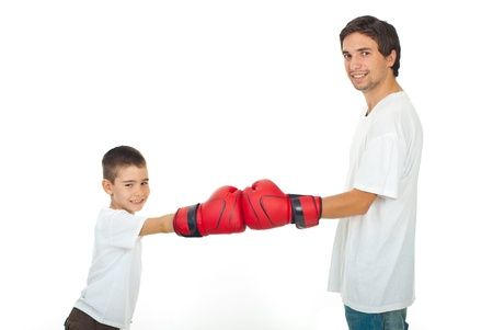 boy boxing: Father and son in white t-shirts having competition with red boxing gloves isolated on white background Stock Photo