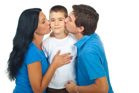 Boy standing in the middle of his parents and being kissed isolated on white background photo