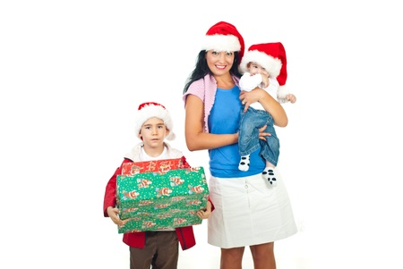 three presents: Mother with their sons wearing Santa hats and the schoolboy holding big  Christmas boxes isolated on white background
