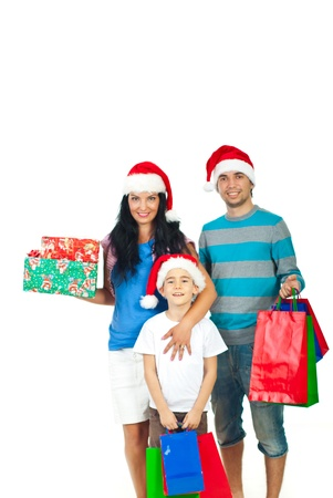 three gift boxes: Happy family with Santa hats holding Christmas presents isolated on white background