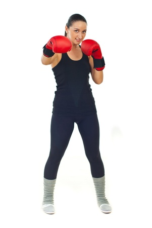 Full length of boxer female with red boxing gloves standing in defensive position isolated on white background photo