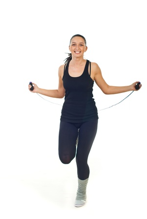 Cheerful woman in action leaping jump rope isolated on white background photo