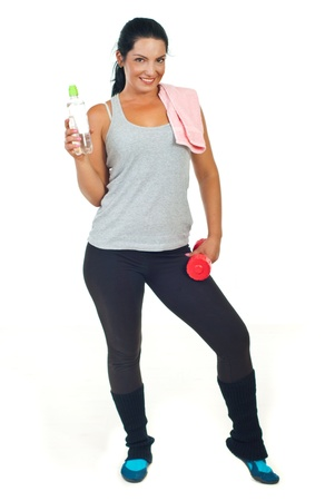 sportwoman: Slim sportwoman holding water bottle,towel and barbell isolated on white background