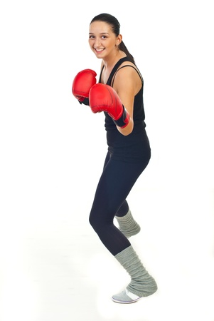 kick boxer: Happy young boxer woman training isolated on white background