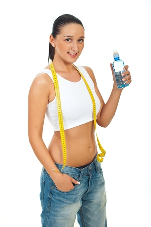 Slim woman with centimeter holding water bottle isolated on white background photo