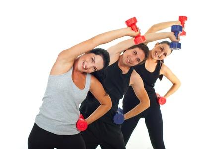 men exercising: Equipo feliz de tres ejercicios con mancuernas peope y estiramiento