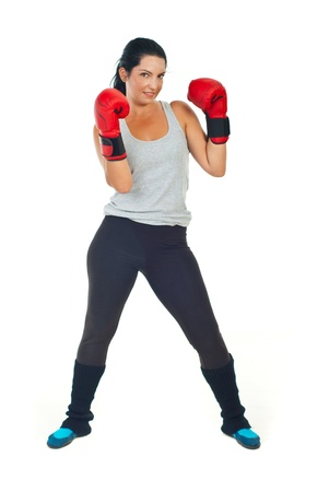 Powerful boxer woman isolated on white background photo