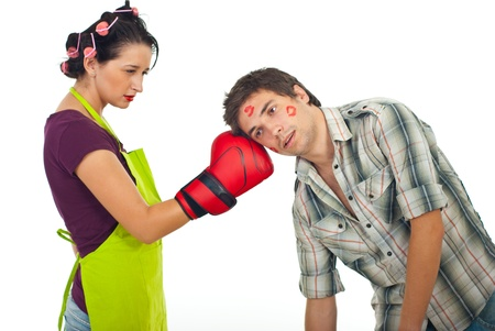 Angry wife boxing unfaithful husband isolated on white background photo