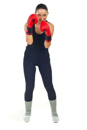 kick boxer: Smiling boxer woman training and defending isolated on white background Stock Photo