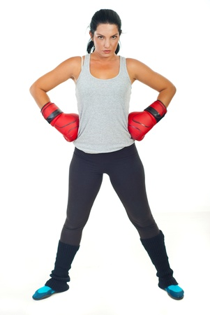 Serious boxer woman standing with hands in boxing gloves  and being ready for fight isolate don white background Stock Photo