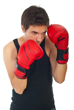 Young boxer man defending isolated on white background photo