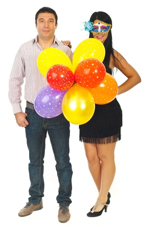Elegant couple with balloons  ready for party isolated on white background photo