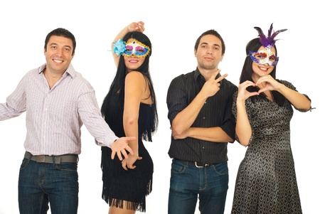Group of four friends having fun at party and posing in different styles isolated on white background photo