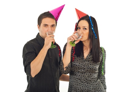 Young couple drinking champagne at new year party isolated on white background photo