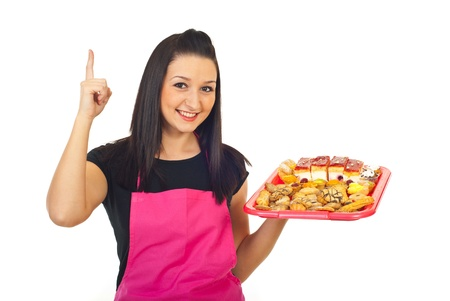 selling points: Confectioner with cakes pointing up to copy space isolated on white background