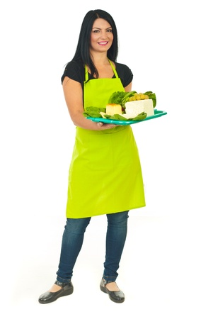 full length woman: Full length of attractive cheese maker female holding full plateau with different type of cheese isolated on white background