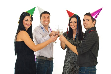 Cheerful friends toasting with champagne at New Years Eve party isolated on white background photo