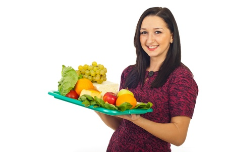 Cheerful female holding plateau with healthy food isolated on white background photo