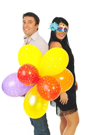 Happy party couple with colorful balloons isolated on white background photo