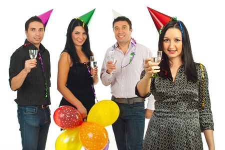 Party woman holding champagne in front of her cheerful friends isolated on white background photo