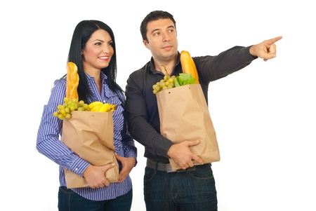Man showing something to his wife at shopping food isolated on white background photo