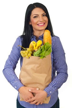 Extremely happy woman holding shopping paper bag with healthy food  isolated on white background photo