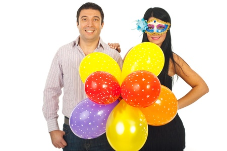 Happy couple holding balloons and being ready for party isolated on white background photo