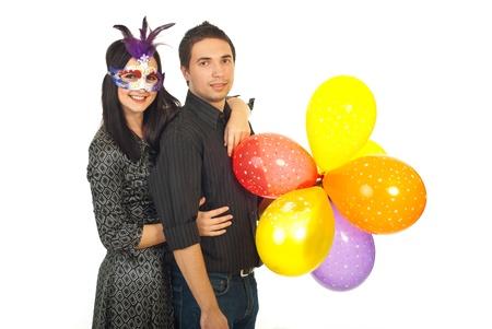 Joyful party couple holding balloons isolated on white background photo