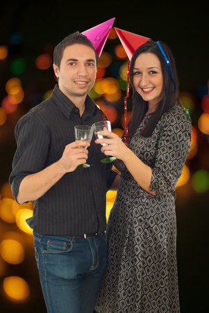 Young couple celebrate new year evening and toasting with glasses on champagne  photo