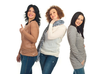 Happy three friends women posing against white background photo