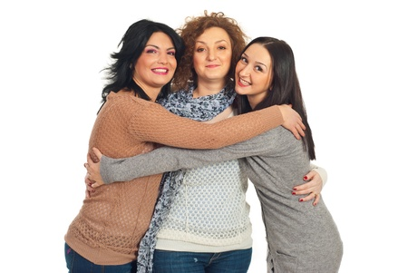 friend hug: Three friends women standing in embrace isolated on white background