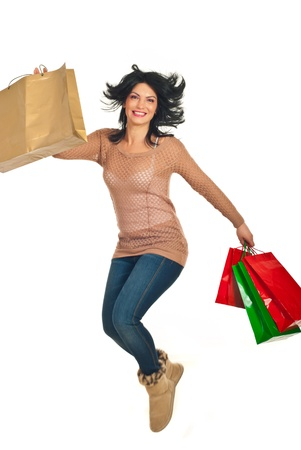 Happy woman jumping with shopping bags isolated on white background Stock Photo - 11756039