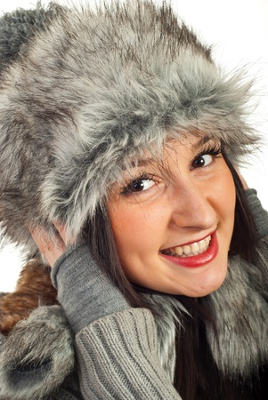 Happy smiling woman in fur hat isolated on white background photo