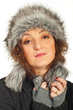 Redhead woman wearing fur hat against white photo