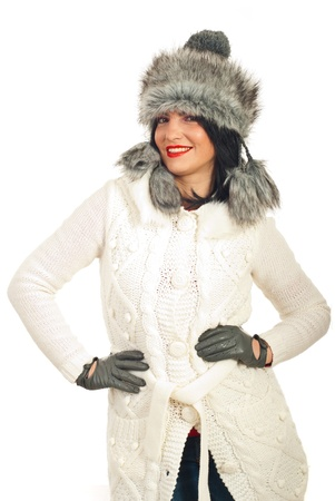 Beauty brunette woman in fur hat,white woolen jacket and gray gloves posing against white background photo