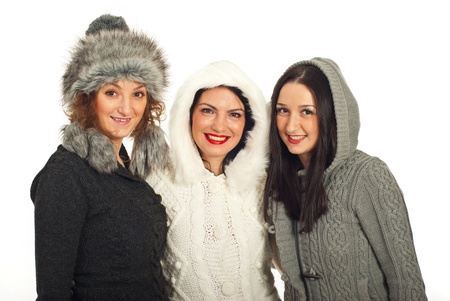Happy winter friends women in woolen pullovers isolated on white background photo