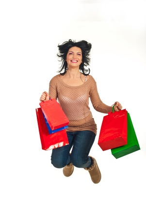 Happy shopper woman with shopping bags jumping in the air isolated on white background Stock Photo - 11756068