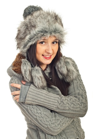 Attractive model woman in gray fur hat and pullover isolated on white background photo
