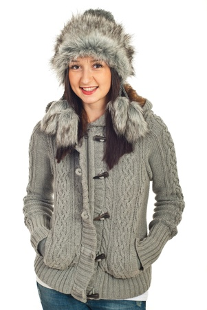 Beauty smiling model woman in fur ha and knit jacket isolated on white background photo