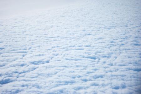 Fluffy clouds seen from above,from plane photo