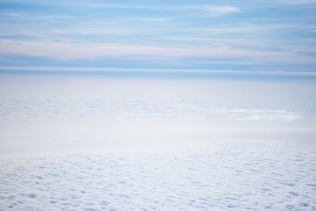 above the clouds: White clouds on blue sky  seen from above taken from plane Stock Photo